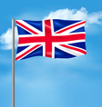 Flag of the United Kingdom on blue sky vector image