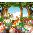 A group of bunnies and easter eggs vector image vector image