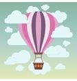 Clouds and striped hot air balloon on a blue vector image