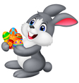 Cartoon bunny holding decorated egg vector image