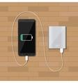 powerbank charging smartphone on wooden desk vector image