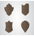Set of four brown leather shield with gold thread vector image
