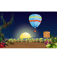A hot air balloon in a bright full moon vector image vector image