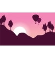 Silhouette of hot air balloon with hill landscape vector image