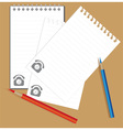 notebook and colored pencils vector image