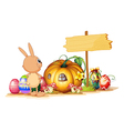 A rabbit easter eggs a pumpkin and an empty vector image