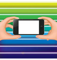 Hands Holding Phone And Colorful Background vector image vector image