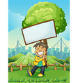 A smiling young man carrying an empty signboard vector image vector image