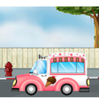 A pink ice cream bus at the road vector image vector image