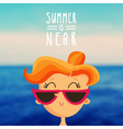 Redhead girl on the blurred sea background vector image