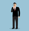 Businessman with a magnifying glass vector image
