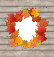 Autumn leaves maple with copy space wooden texture vector image