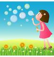 Cute girl blowing bubbles on the lawn vector image