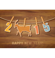 2015 with a goat on wooden background vector image