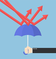 Businessman hand using umbrella to protect downtre vector image