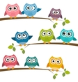 Set of colorful cartoon owls on branches vector image