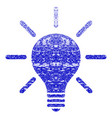 light bulb grunge textured icon vector image