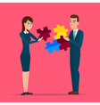 business man and business woman holding puzzle vector image