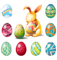 A group of Easter eggs and a sweet bunny vector image