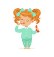 beautiful cartoon redhead girl in a light blue vector image