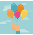 hand holding balloons vector image vector image