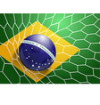 Soccer ball in net with brazil flag vector image vector image