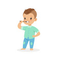 cute cartoon boy brushing his teeth kids dental vector image