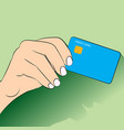 hand holdign credit cart flat design - vector image