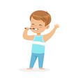 adorable cartoon boy brushing his teeth kids vector image