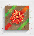 gift box wrapped on brown wrinkled paper with red vector image