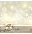 Golden ribbon bow with bokeh Christmas decoration vector image