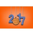 Basketball and 2017 hanging on strings vector image