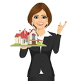 real estate agent holding a model house vector image