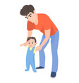 cartoon father teaching his son to walk vector image