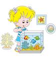 Girl looking at aquarium fishes vector image