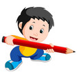 young boy holding a big pencil vector image
