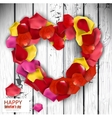 Beautiful heart made from rose petals on wooden vector image vector image