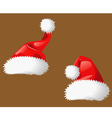 Two Santa Clous christmas hats vector image vector image