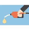 Hand holding gas fuel pump nozzle vector image
