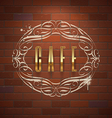 Cafe ornate golden sign on vintage brick wall vector image