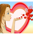 Girl blowing hearts shape vector image