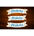Oktoberfest banner on old wooden texture vector image