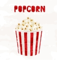 Popcorn in striped bucket on white background vector image