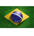 Soccer ball with brazilian flag on soccer field vector image