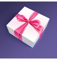 White gift box with red ribbon and bow vector image