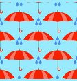 red umbrellas seamless pattern isolated on blue vector image