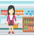 Woman with pack of beer at supermarket vector image