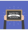 Hand holding sign back to school vector image