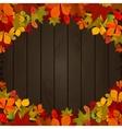 Autumn leaves on dark wooden background Design vector image