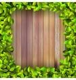 Fresh spring leaf plant over wood EPS10 vector image